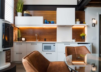 The Wall kitchenette and fireplace